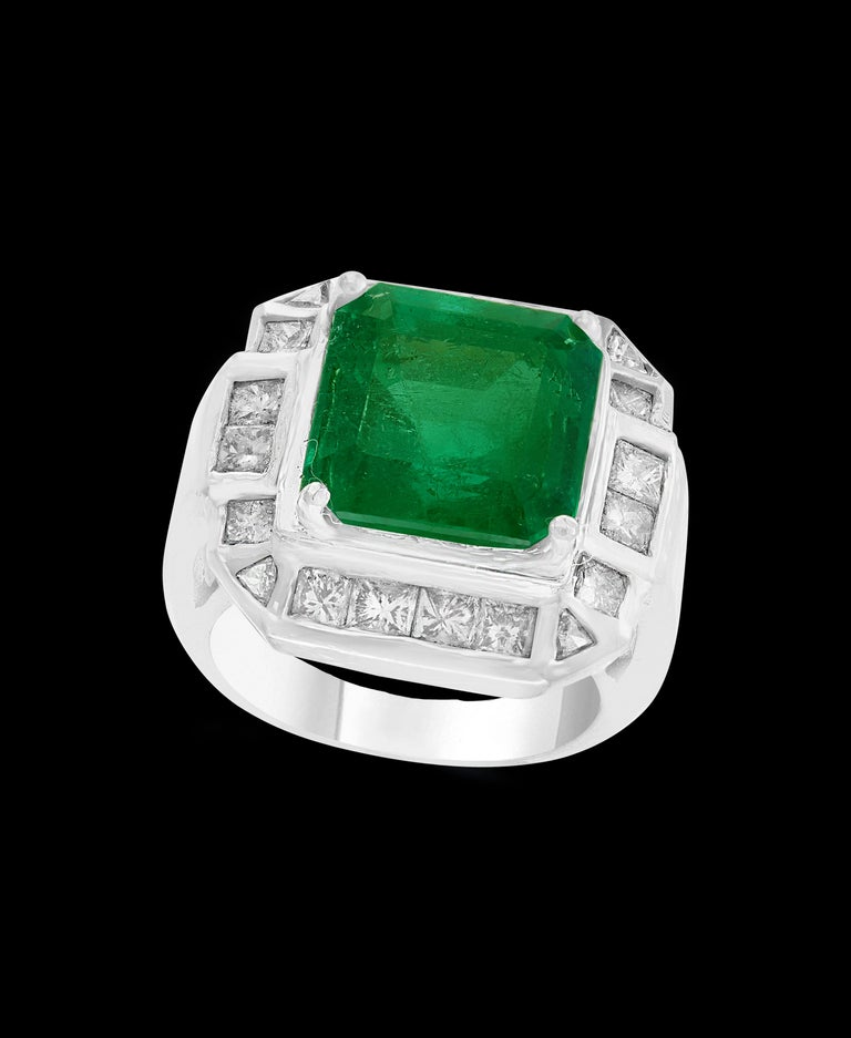 A classic, Cocktail ring  9 Carat  Colombian Emerald and Diamond Ring, Estate. AGL ( American Gemology Institute) known as the best institute to certify color stone) AGL The Prestige Gemstone Report # CS 58188 Natural Beryl Emerald Origin