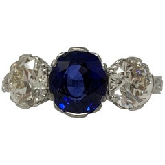 AGL Certified Blue Sapphire Oval Mixed Cut and white Diamond Three-Stone Ring