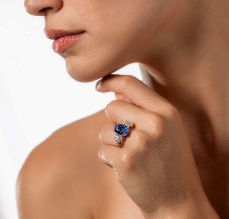 An oval mixed cut American Gemological Lab and Colombo Gemological Lab certified natural no heat Ceylon (Srilanka) 8.01 carat blue sapphire and diamonds ring. Sapphire is medium dark tone, strong saturation, blue hue. Measured 11.91 mm x 8.82mm x