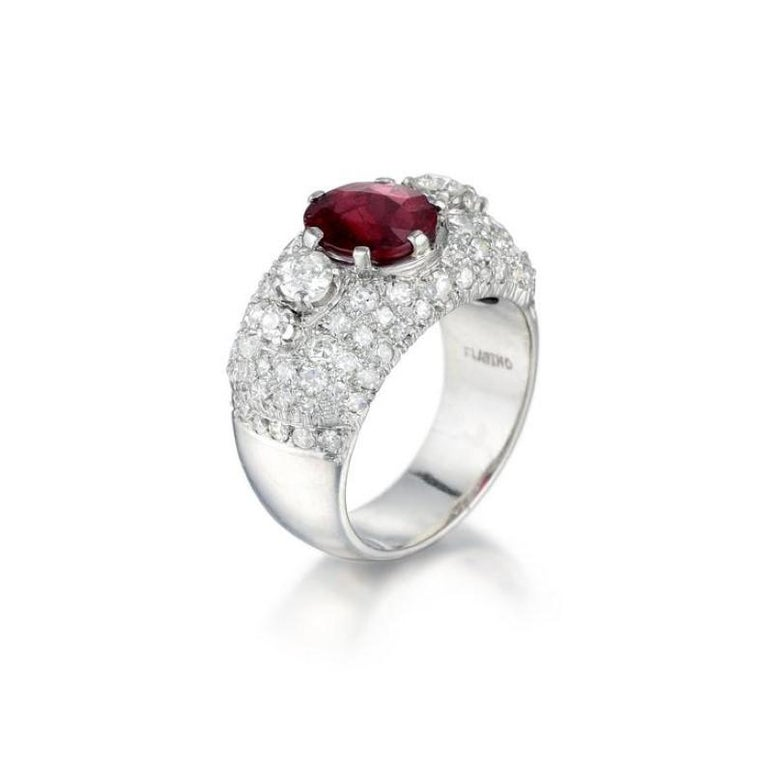 A vibrant platinum, ruby and diamond ring featuring an oval cut red 2.22 carat unheated Thai ruby (AGL certified), surrounded by old European- and single-cut diamonds weighing a total of approximately 1.85 carats, most with H-J color and VS-SI