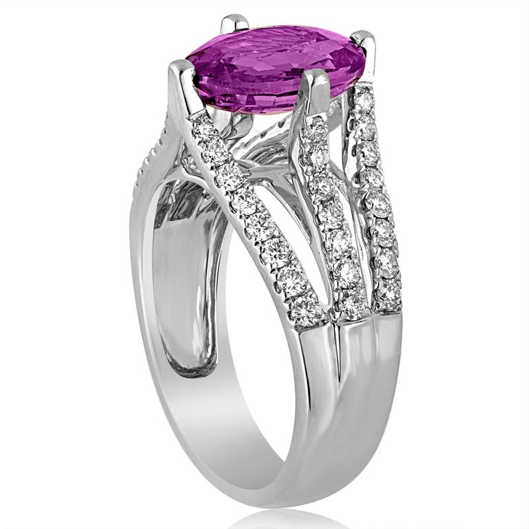 Very Stunning Sapphire Ring The ring is 18K White Gold The center stone is an Oval 2.86 Carat Purple Pink Sapphire The sapphire has NO HEAT and is certified by AGL. There are 0.60 Carats in Diamonds F VS The ring is a size 5.75, sizable. The ring