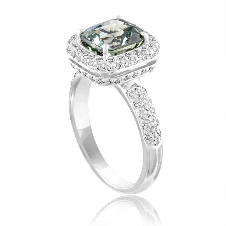 Beautiful Cushion Cut Halo Pave Ring The ring is 18K White Gold The Center Stone is a Cushion Cut Grayish Green Sapphire 3.34 Carats The Sapphire is AGL Certified NO HEAT There are 0.68 Carats in Diamonds F/G VS/SI The ring is a size 6.50,