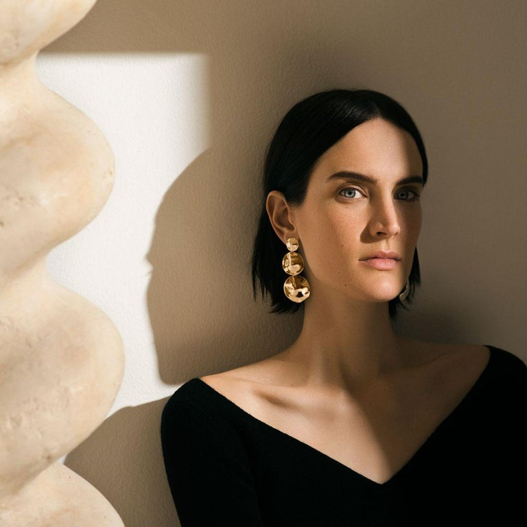 AGMES Gold Vermeil Long Layered Round Drop Earrings. Gold Vermeil post. Also available in Sterling Silver. Handmade in New York City. Inspired by urban landscapes, architecture and modern art, the collection creates a feminine geometry expressed
