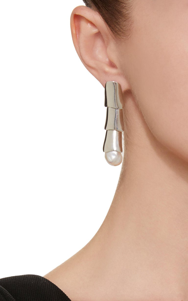 AGMES Sterling Silver Layered Drop Dangle Earrings with Freshwater Pearls. Sterling Silver post. Also available in Gold Vermeil. Handmade in New York City. Inspired by urban landscapes, architecture and modern art, the collection creates a feminine