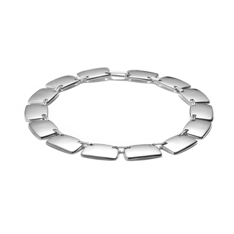 AGMES Sterling Silver Unique Elegant Link Collar Necklace. Handmade in New York City. Inspired by urban landscapes, architecture and modern art, the collection creates a feminine geometry expressed through clean lines and sculptural silhouettes.