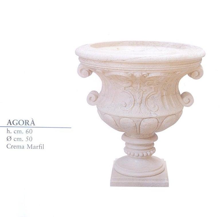 Multi-purpose Agora urn in crema marfil marble. Perfect for garden or home decor.