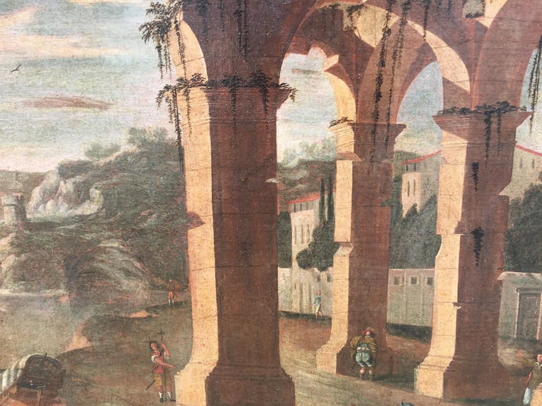 17th century Italian harbor with boats, figures and ruins in a landscape  - Painting by (Follower of) Agostino Tassi