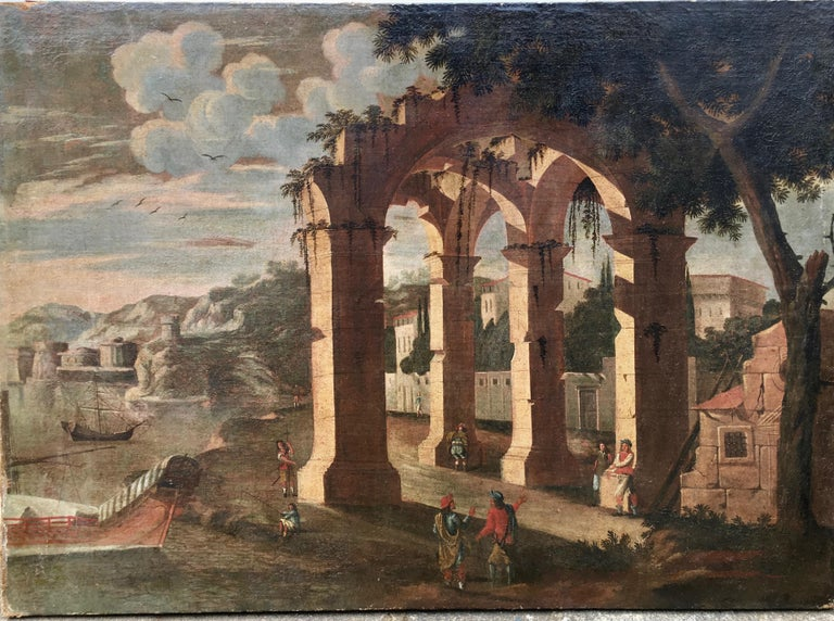 (Follower of) Agostino Tassi Figurative Painting - 17th century Italian harbor with boats, figures and ruins in a landscape
