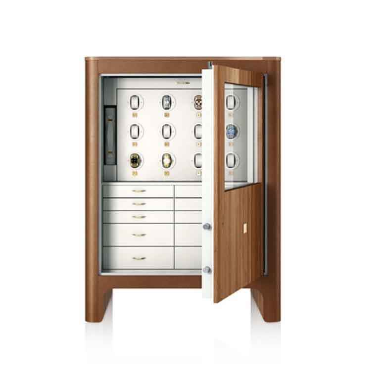 Polished walnut armored chest with leather inserts and 24-karat gold-plated accessories. Biometric opening device and emergency key system. Bullets proof certified P6B glasses. Gentleman side: 12 Swiss made watch winders and drawers. Lady side: