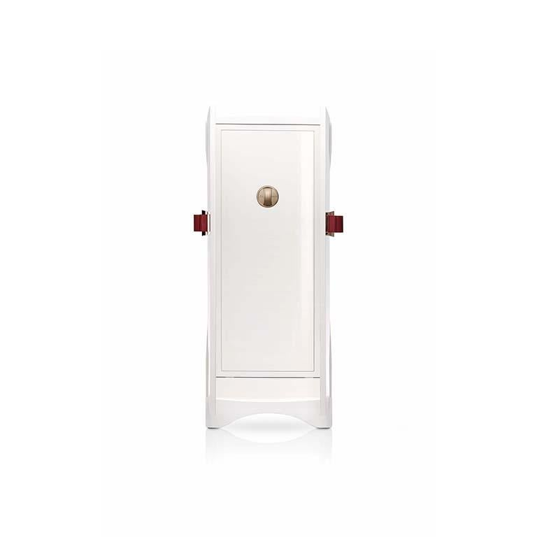 Polished white bird's-eye maple armored armoire with leather bow, 24-karat gold-plated accessories. Round handle with biometric opening device and emergency key integrated. Inside pullout / pull-out necklace holder and drawers lined for jewelry.