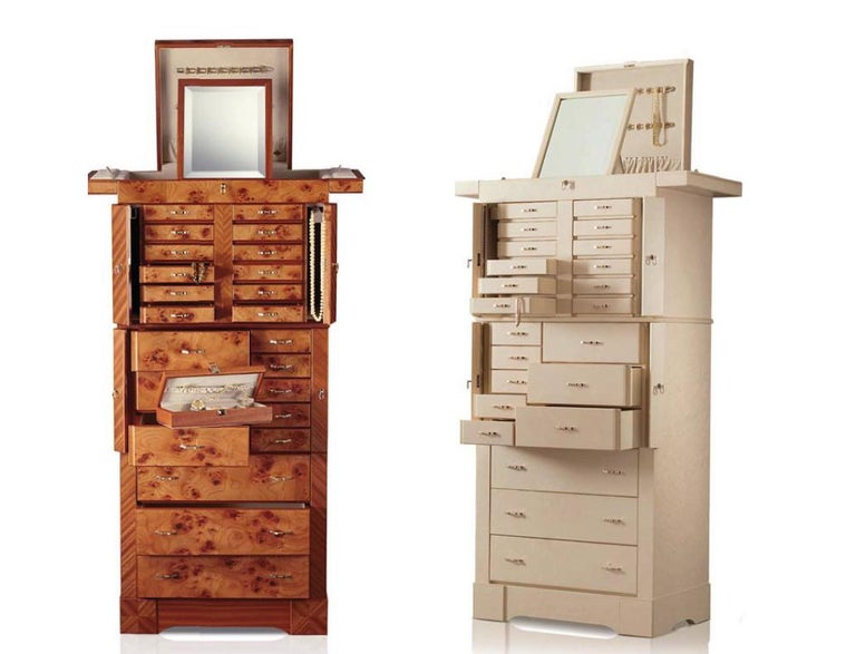 Agresti Grande Scrigno; contemporary jewelry armoire in matte finish elm briar and mahogany. Twenty lockable drawers are lined for all kinds of jewelry. The three large bottom ones do not have locks. The upper part has two pull-out necklace bars and