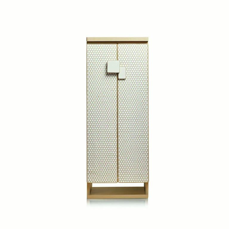 Agresti Gioia Intreccio; contemporary armored jewelry armoire safe covered in white and beige threaded leather. Inside safe in shiny white. 24-karat gold-plated brass accessories. Made in Florence, Italy by Agresti since, 1949.  Safety, elegance,