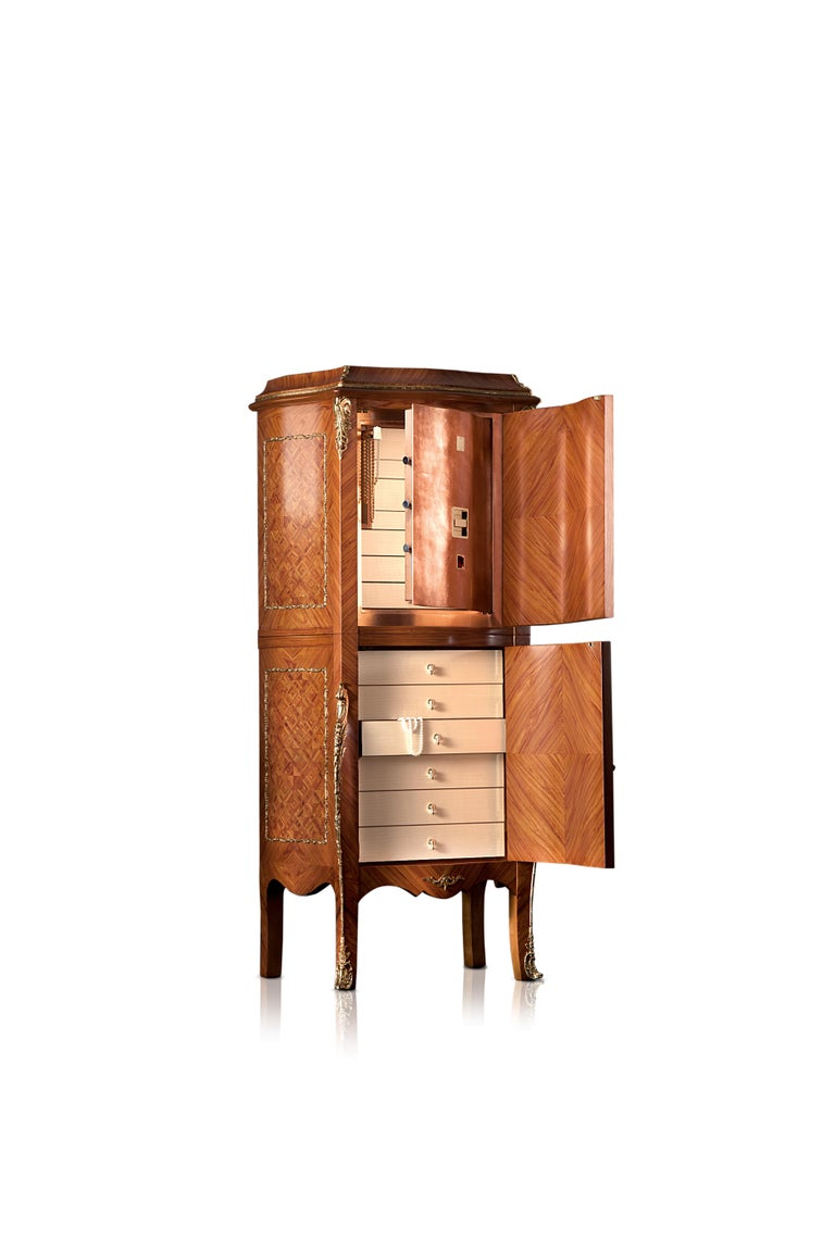 Shaped armoire in rosewood and maple. Louis XV replica, with bronze details. Contents safe in polished copper foil, 24-karat brass parts. Safes to be anchored to the wall with metal screws. Biometric opening device (upto 99 authorized users) and
