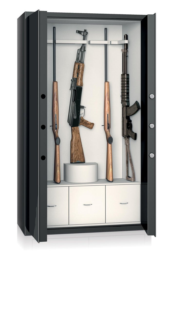 Armored armoire in shiny black steel. Inside drawers in polished white bird's-eye maple, 24-karat gold-plated brass accessories. Gun storage capacity.