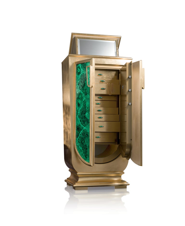 Armored jewelry armoire with pullout / pull-out necklace bar. Shaped armoire in gold leaf and malachite. Inside safe in gold shiny. 24-karat gold-plated brass accessories. Handles in Malachite. Available with 3-6-9 (or more) watch winders, entirely