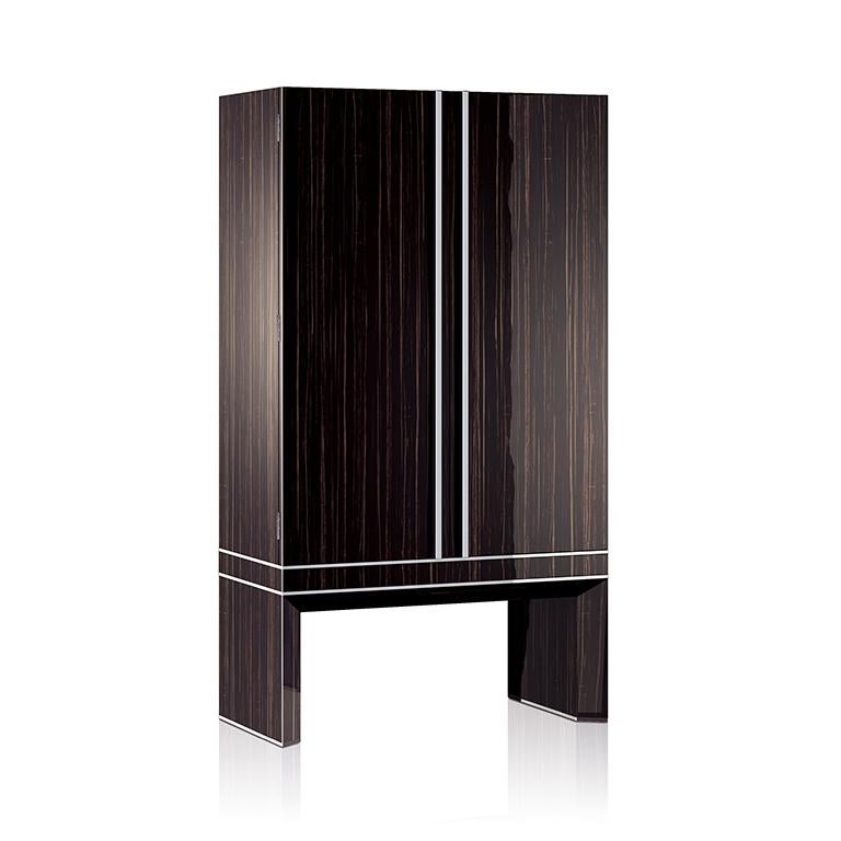 Armored armoire in polished Ebony, brass accessories in Ruthenium. Safe with biometric opening device, drawers and trays lined for watches and jewelry. Available with 54 Swiss made watch winders. Two secret compartments. Safe to be anchored to the