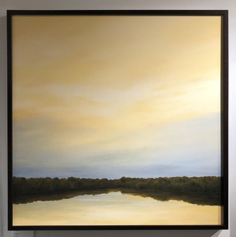This medium sized minimalist painting depicts subtle shift of color from gold to cream and then to pale blue gray in a sky reflected back in the river.  The painting is bisected by a line of trees creating a focal point towards the lower half of the