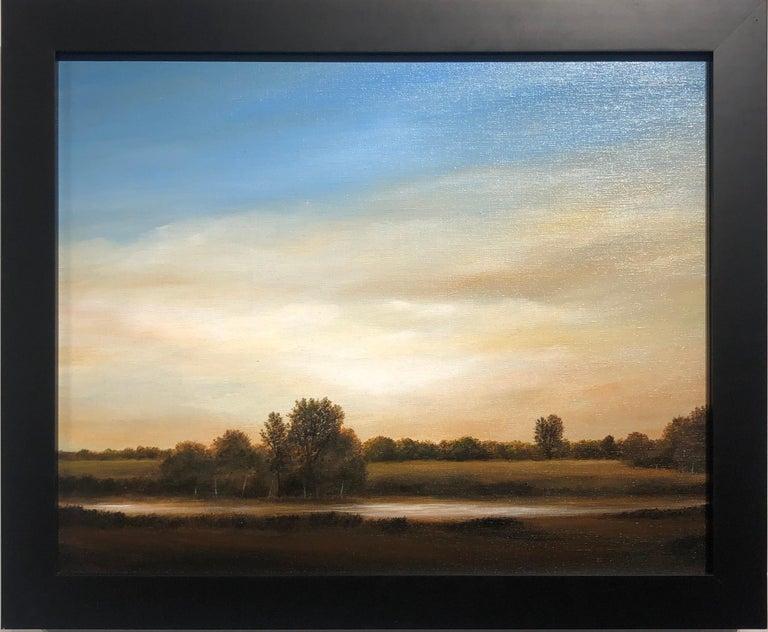 Streams of Bloomington, Serene Landscape with Vast Hazy Blue Sky, Framed - Painting by Ahzad Bogosian