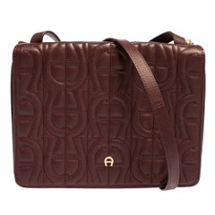Aigner Burgundy Logo Embossed Leather Flap Crossbody Bag