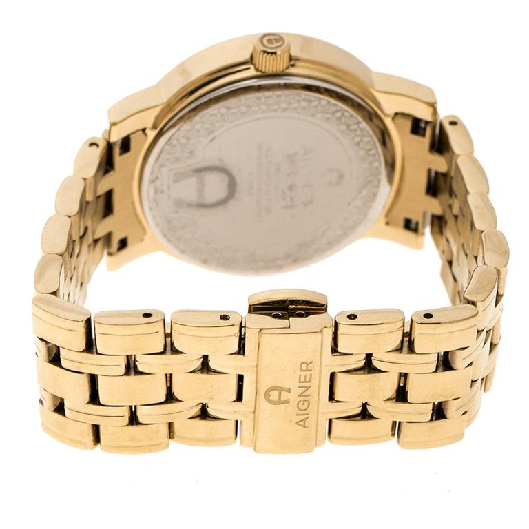 Aigner is considered the first voguish brand for stylish living from Germany. This champagne gold plated stainless steel women's wristwatch by Aigner is a fashionable example of the aforementioned. The watch features a fancy round bezel with