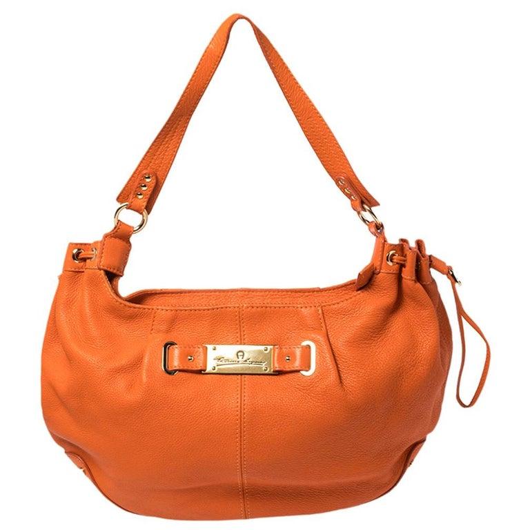 Aigner Orange Leather Logo Drawstring Hobo For Sale