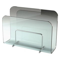 Air Magazine Rack Casted in One Slab of Curved Clear Glass
