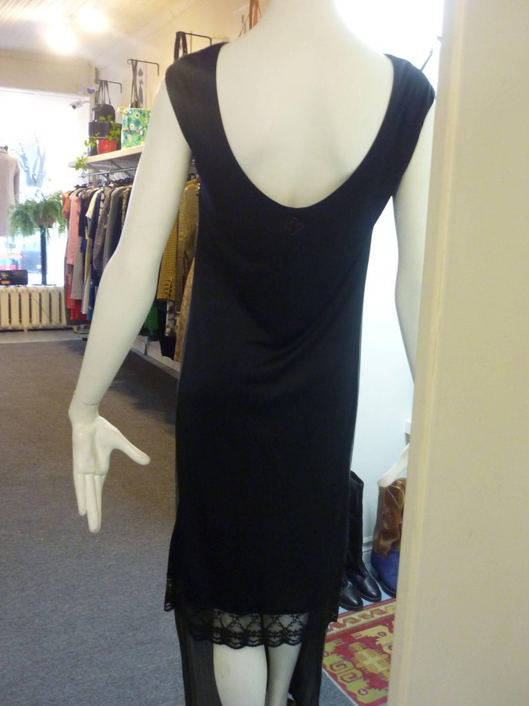 This is a very original dress in a cotton blend with a long cotton grey striped front and a black acetate/rayon shorter back with lace bottom.  It is both elegant and playful.