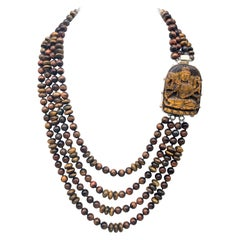 A.jeschel 4 Strand Graduated Tiger's Eye Necklace with a Powerful Carved Clasp