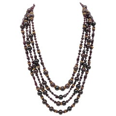 A.Jeschel 4- strands of richly colored Garnet and vermeil necklace.
