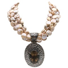 A.Jeschel 5 strand coin pearl necklace and Smokey Quartz necklace.