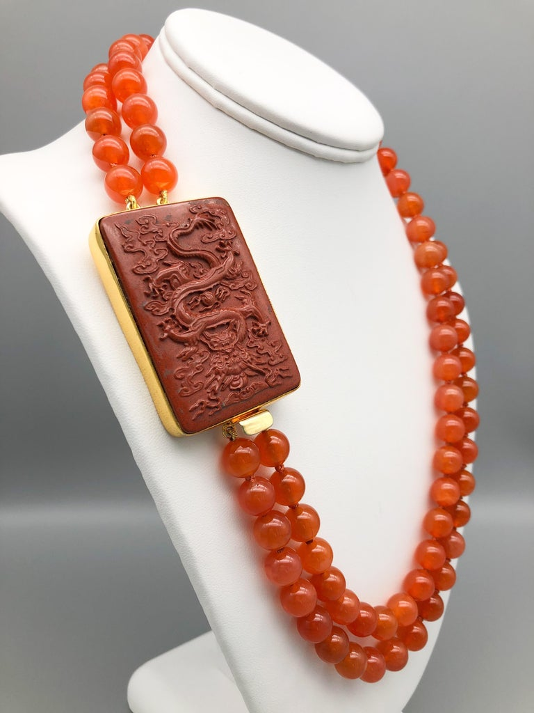 Contemporary A.Jeschel An Aventurine Dragon clasps a double strand of Carnelian beads For Sale