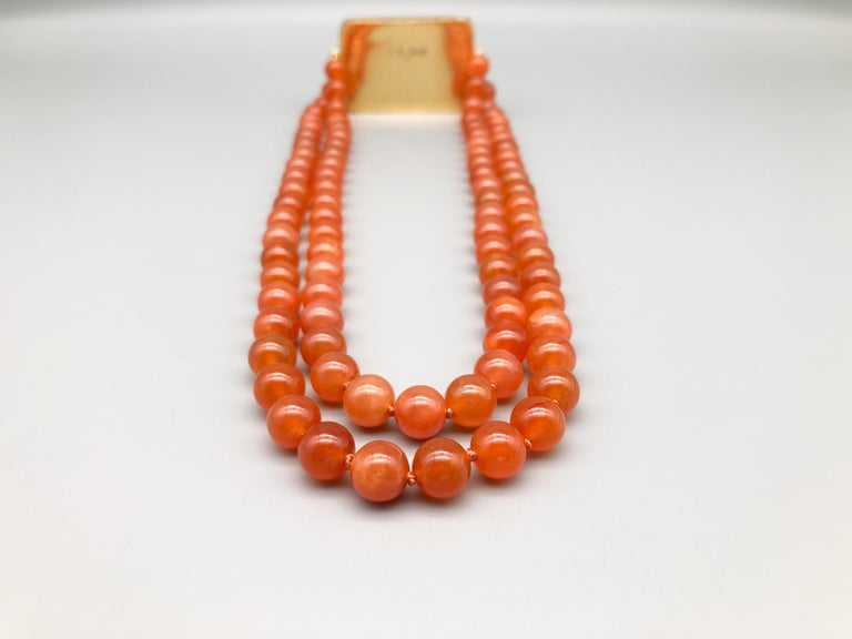 Bead A.Jeschel An Aventurine Dragon clasps a double strand of Carnelian beads For Sale