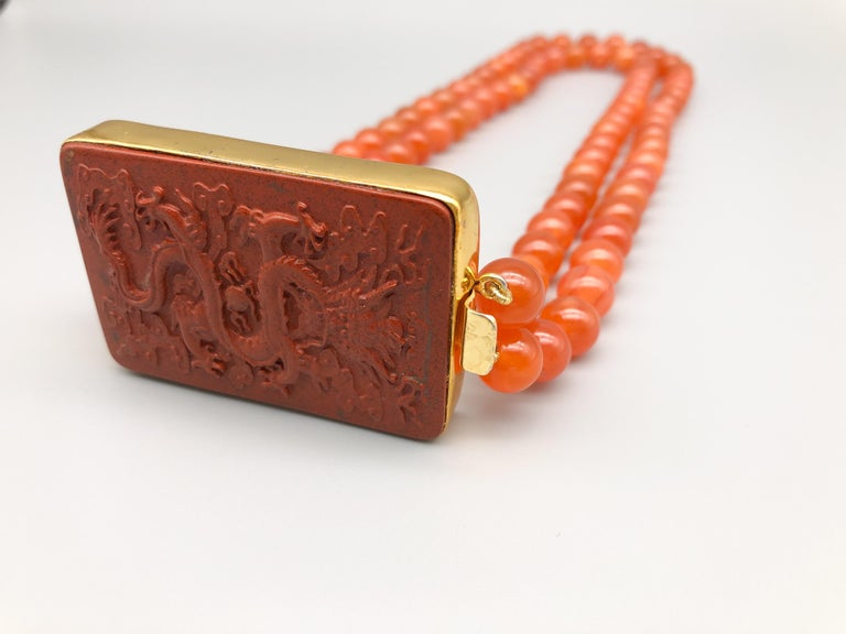 A.Jeschel An Aventurine Dragon clasps a double strand of Carnelian beads In New Condition For Sale In Miami, FL