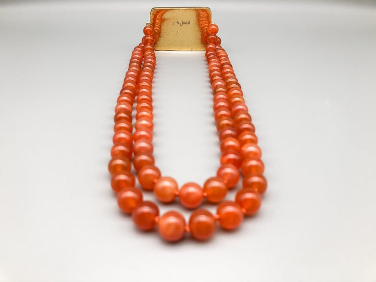 A.Jeschel An Aventurine Dragon clasps a double strand of Carnelian beads For Sale 1