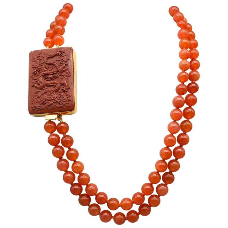 A.Jeschel An Aventurine Dragon clasps a double strand of Carnelian beads For Sale