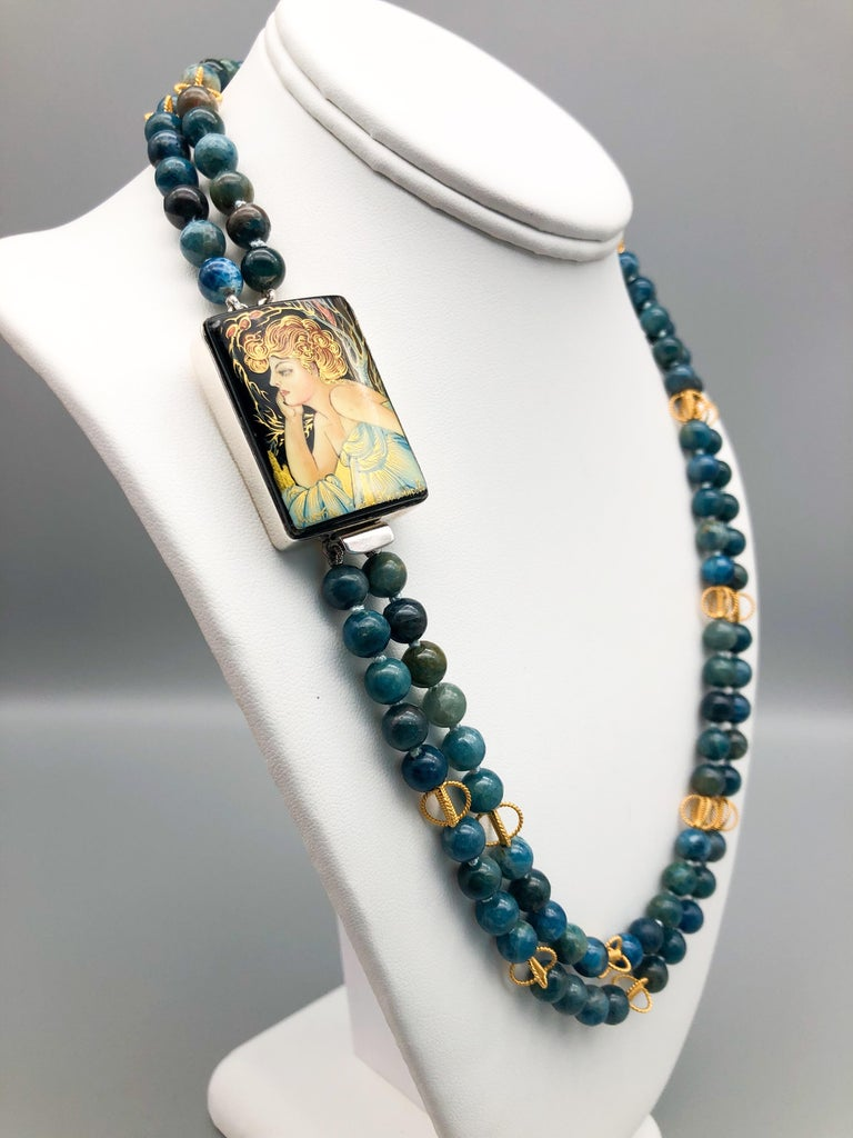 One-of-a-Kind A double strand of 8mm Apatite beads punctuates by delicate filigree beads spaced at intervals. The beads provide the backdrop for the lovely Russian Miniature Sterling Silver box clasp meticulously painted in the traditional manner