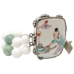 A.Jeschel Double strand carved jade and agate bracelet.