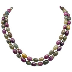 A.Jeschel  Double strand pink and green Sapphire necklace.
