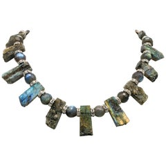 A.Jeschel Labradorite polished and rough plates with accent grey Pearls
