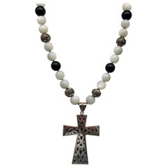 A.Jeschel Large Sterling Silver Cross hangs from a Moonstone and Onyx Necklace