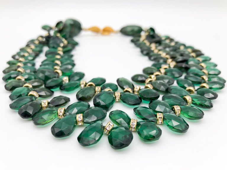 One-of-a-Kind Show stopper double-strand faceted Green Quartz, teardrop cut beads have a vitreous luster with high brilliance, show exceptional faceting and polish, are well-matched with Cz spacers, and 2 hand-cut faceted Emeralds. The necklace is