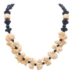 A.Jeschel Onyx and Carved Bone Chinese zodiac necklace