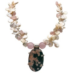 A.Jeschel Pink Ocean Jasper pendant suspended from a pearl and Rose Quartz