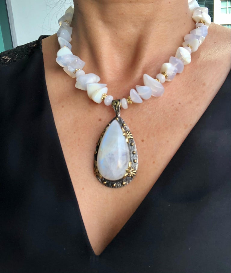 One-of-a-Kind  The lustrous play of Iridescent light in this necklace is the perfect example of what is meant by opalescence. A strand of natural Opal nuggets surround a fine large Opal pendant set by Bora in an oxidized Sterling Silver and vermeil