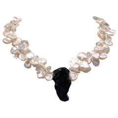 A.Jeschel Solid Black Tourmaline pendant with a double Strand of Pearls.