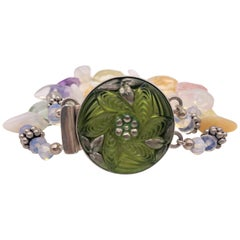 A.Jeschel Two strands assorted Quartz and white Opal bracelet.