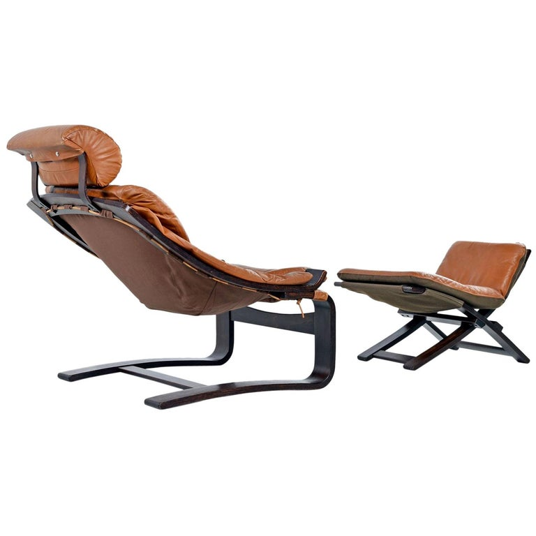 What's better than a vintage rosewood Kroken chair with original cognac leather and matching ottoman? A Kroken chair with a brand new canvas sling. We kept the supple leather and sewed the canvas and loops according to the original pattern. Ready
