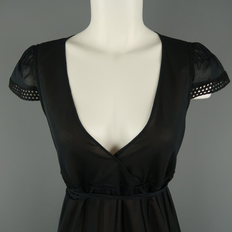 AKRIS peasant style dress comes in sheer black sheer cotton with a wrap V neck, short eyelet lace trimmed sleeves, and tiered A line skirt with wrap tie belt. Made in Switzerland.   Very Good Pre-Owned Condition. Marked: 8   Measurements: