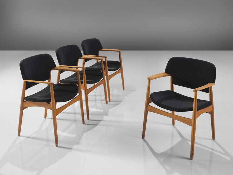 Aksel Bender Madsen for Fritz Hansen, oak and black fabric upholstery, Denmark, circa 1955.  These wide dining chairs are executed with a rounded back. The chairs feature a blond oak frame that forms a great colour palette with the black fabric. The