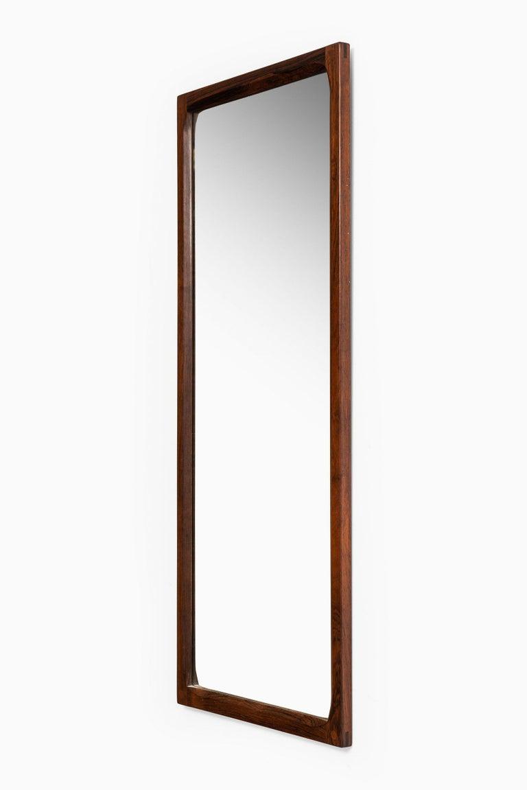 Mirror in rosewood designed by Aksel Kjersgaard. Produced by Odder in Denmark.
